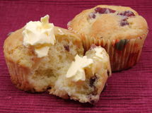 Two Orange Cranberry Muffins With Butter. Royalty Free Stock Image