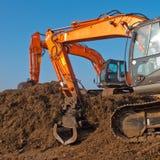 Two orange excavators Royalty Free Stock Photography