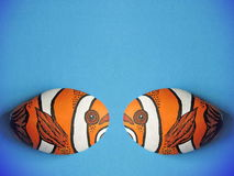 Two orange fish painted on stone Stock Images