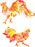 Two orange flame roosters on white Royalty Free Stock Photos