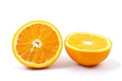 Two orange halves. Isolated on the white background Royalty Free Stock Image