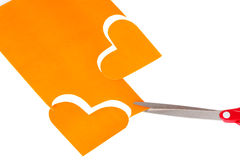 Two orange heart shapes cut out of paper Stock Photo