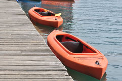 Two orange kayak Royalty Free Stock Photos