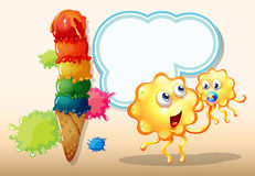 Two orange monsters near the big icecream Royalty Free Stock Image