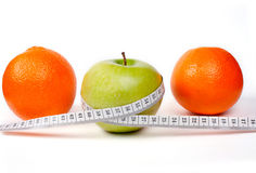 Two orange and one  green apple with tape Royalty Free Stock Photography