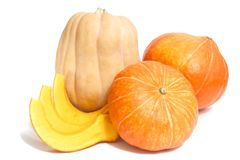 Two orange and one yellow pumpkinswith three slices. Two orange and one yellow pumpkins with three slices on white royalty free stock photo