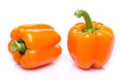 Two orange peppers Stock Photography