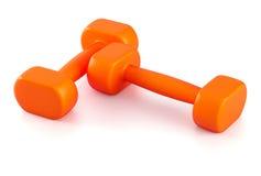 Two orange plastic dumbbells. Two orange plastic 1 kg dumbbells on white background Royalty Free Stock Photos