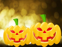 Two orange pumpkins on gold blurred background. Halloween Royalty Free Stock Photography