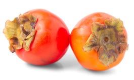 Two orange ripe persimmon Stock Photos