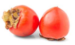 Two orange ripe persimmon Stock Images
