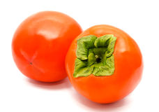 Two orange ripe persimmon isolated Stock Photography