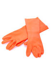 Two orange rubber gloves isolated Stock Photography