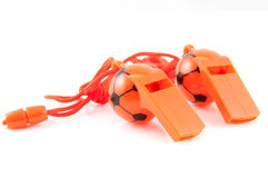 Two orange soccer whistles Stock Photos
