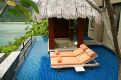 Free Two Orange Sun Beds In Private Outdoor Spa  Stock Photo - 13313120