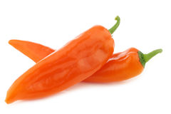 Two orange sweet peppers(capsicum) Stock Photos