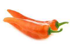 Two orange sweet peppers(capsicum) Stock Images