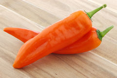 Two orange sweet peppers(capsicum) Stock Photo