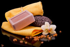 Two orange terry towels and soap handmade orchid flower and sea Stock Image