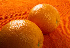 Two Orange on the textile background Royalty Free Stock Photography