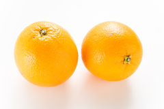 Two orange in white isolated. Two Orange isolated on white background Royalty Free Stock Photo