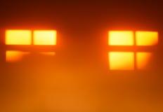 Two orange windows silhouettes bokeh background Stock Photo