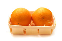Two oranges. Two ripe oranges in a wicker basket Royalty Free Stock Image
