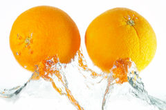 Two oranges. Jumping out of the water Royalty Free Stock Photo