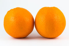 Two oranges. Two oranges isolated on white background royalty free stock images
