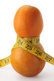 Two oranges and measure tape. Two oranges vertical tape measure waist 25 inch Royalty Free Stock Photo