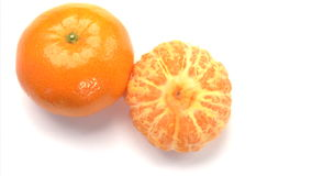 Two oranges. One peeled stock video footage