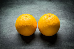Two oranges. On a plate Royalty Free Stock Images