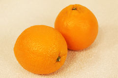 Two oranges Stock Images