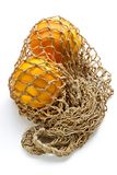 Two oranges in string-bag Stock Photography