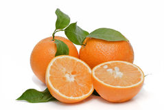 Two oranges and two halves. Royalty Free Stock Images