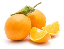 Orange, appelsin isolated. Two oranges and two quarters isolated on white background one with green leaf Royalty Free Stock Photos