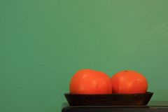 Two oranges on wood tray Royalty Free Stock Photo