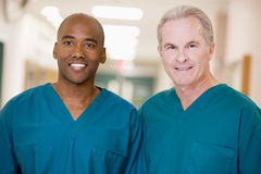 Two Orderlies Standing In A Hospital Corridor Stock Photography