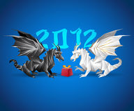 Two origami dragons and a present. 2012 year in the background stock illustration