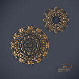 Two ornamental gold flower oriental mandalas on blue color backg Royalty Free Stock Images