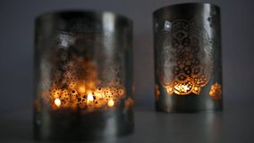 Two ornamental lanterns with burning candles. stock video footage