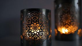 Two ornamental lanterns with burning candles. stock footage