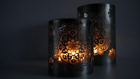 Two ornamental lanterns with burning candles. Festive glittering bokeh lights background stock video footage
