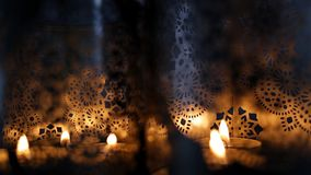 Two ornamental lanterns with burning candles. Festive glittering lights de focused, bokeh or blur candle lighting abstract Background stock video