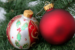 Two Ornaments. Two Christmas ornaments hanging in a tree stock photos