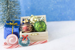 Two ornaments in wooden chest Royalty Free Stock Images
