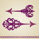 Two ornate decorated  arrows in Victorian style. Stock Image