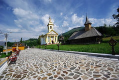 Two orthodox churches. First one historic monuments, wooden made, the second one newer Royalty Free Stock Image