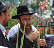 Two Orthodox Jews in black hats picks Lula Royalty Free Stock Photos
