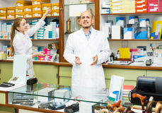 Two orthopedists working in special store with orthopaedic goods Royalty Free Stock Photography